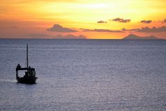 Dhow Boat at sunset Stock Photo