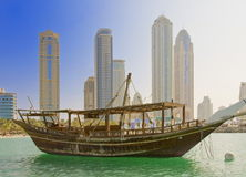 Dhow and Buildings. Dhow, the antique wooden vessel used in the Arabic sea and Dubai skyline Stock Photography