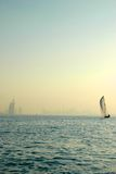 Dhow and Burj Al Arab in the Gulf. Dhow sailing and Burj Al Arab in the Gulf Royalty Free Stock Image