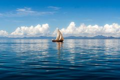 Dhow. Floating off Nosy Be, Madagascar Stock Photo