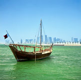 Dhow and Doha skyline. A traditional Arab dhow of the common Shuw\'ai type moored in Doha Bay, Qatar, with the city\'s modern skyline in the background Stock Image