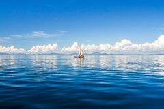Dhow. Floating off Nosy Be, Madagascar Stock Photos
