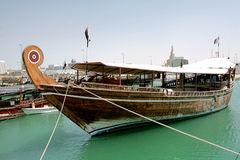 Dhow in harbour. An Arabian pleasure cruisine dhow tied up in the Dhow Harbour, on the Doha Corniche Stock Photography