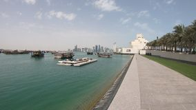 Dhow Harbour Doha. Doha seafront with palm trees and West Bay skyline along Corniche in Qatari capital with Dhow Harbour in a sunny day. Doha in Qatar. Middle stock video