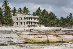 Dhow and local home on Zanzibar beach Royalty Free Stock Photography
