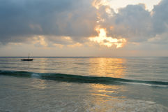 Dhow on the ocean at sunrise Stock Photos