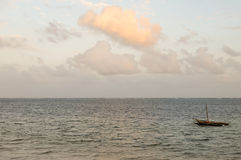 Dhow on the ocean at sunrise Royalty Free Stock Photo
