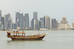 Dhow sails past towers Royalty Free Stock Image