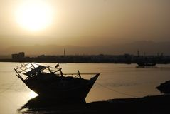 Dhow at sunset. Traditional Arab dhow moored at sunset Stock Images