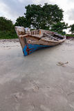 Dhow traditional sailing vessel moored on a beach Stock Photos