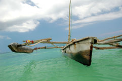 Dhow waiting. To bring tourists out to the nearby coral reefs for snorkeling in Paje. It's to late to fishing Stock Photos