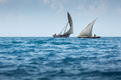 Dhow wooden fisher boat on the Indian Ocean near Zanzibar, Tanza Royalty Free Stock Image
