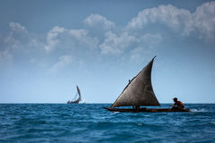 Dhow wooden fisher boat on the Indian Ocean near Zanzibar, Tanza Royalty Free Stock Images