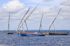 Dhows anchored off the Island of Mozambique. The Island of Mozambique (Portuguese: Ilha de Moçambique) lies off northern Mozambique, between the Mozambique Royalty Free Stock Photography