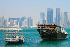 Dhows in front of the skyscrapers of New Doha, Qatar Royalty Free Stock Photo