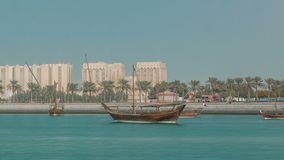 Dhows moored off Museum Park timelapse in central Doha. Qatar, Arabia, with some of the buildings from the city`s commercial port in the background stock video footage
