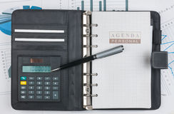 Diário, calculadora e pena Fotografia de Stock Royalty Free