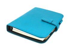 Diário de couro azul do negócio isolado no fundo branco Fotografia de Stock Royalty Free