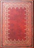 Diário de couro vermelho Backdroung de Petterned do ouro Imagens de Stock