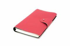 Diário de couro vermelho do negócio isolado no fundo branco Fotos de Stock Royalty Free