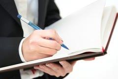 Diário do negócio no close up das mãos Imagem de Stock Royalty Free