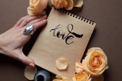 Diário ou caderno com amor da palavra imagens de stock royalty free