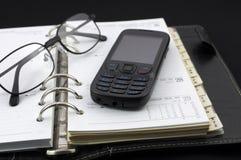 Diário pessoal e telefone móvel Foto de Stock Royalty Free