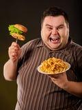 Diät failurFat Fleisch fressendes Schnellimbiß hamberger Stockbild