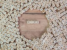 Diät, German text for diet, word in letters on cube dices on table.  royalty free stock images