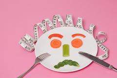 Diät-Salat-Gesicht stockbilder