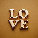 ` Di amore del ` di parola singola nell'iscrizione dell'oro Fotografia Stock