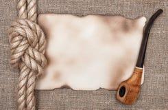 Di carta invecchiato con la corda della nave ed il tubo di tabacco Fotografia Stock Libera da Diritti