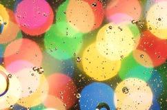 di cerchi colorati Multi e un fondo vago fotografia stock libera da diritti