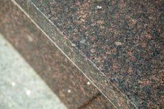 Di fronte al materiale da un monumento del granito Immagini Stock Libere da Diritti
