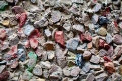 Di ghiaia e di cemento decorati colorati multi di struttura del fondo sopra Fotografie Stock