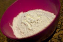 Di latte in polvere con l'emblema m. Fotografia Stock