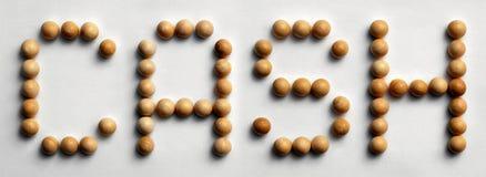 ` Di legno dei contanti del ` di arte di parola della puntina Fotografia Stock Libera da Diritti