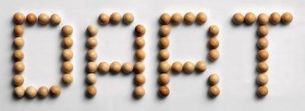 ` Di legno del dardo del ` di arte di parola della puntina fotografie stock libere da diritti