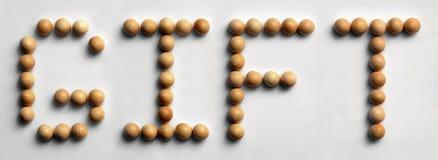 ` Di legno del regalo del ` di arte di parola della puntina fotografie stock libere da diritti