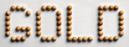 ` Di legno dell'oro del ` di arte di parola della puntina fotografia stock libera da diritti