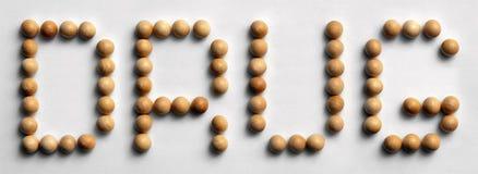 ` Di legno della droga del ` di arte di parola della puntina Fotografia Stock