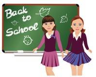 Di nuovo al banco Piccola scolara sveglia Immagine Stock