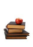 Di nuovo al concetto del banco con i libri e la mela Immagini Stock