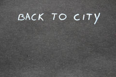 Di nuovo alla città handwritten fotografia stock