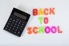 Di nuovo alla scuola che impara le lettere e calcolatore Fotografia Stock