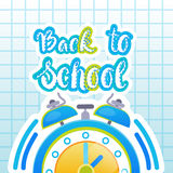 Di nuovo alla scuola Logo Clock On Notebook Background Fotografie Stock