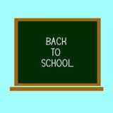 Di nuovo alla scuola, scritta sulla lavagna con gesso Fotografia Stock