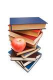 ?Di nuovo concetto al banco? con i libri e la mela fotografia stock libera da diritti