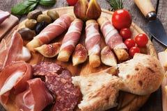 Di Parma do Prosciutto e o outro alimento italiano foto de stock