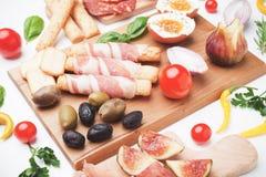 Di Parma do Prosciutto e o outro alimento italiano imagens de stock royalty free